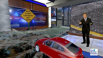 Display of flooding impact using Max Reality in a virtual set.